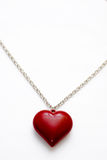 Necklace with heart shaped pendant. A silver necklace with a large heart shaped pendant royalty free stock image