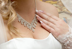Necklace on her breast bride Stock Photography
