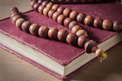 Necklace on holy book. Royalty Free Stock Photos