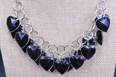 NECKLACE. JEWELERY NECKLACE WITH BLACK HEART SHAPED BEADS stock images
