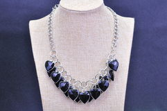 NECKLACE. JEWELERY METAL NECKLACE WITH BLACK COLOR BEADS royalty free stock images