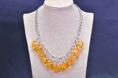 NECKLACE. JEWELERY METAL NECKLACE WITH PLASTIC BEADS royalty free stock photo