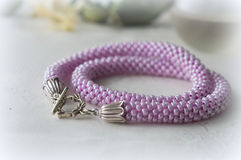 Necklace from a large lilac beads Stock Photo