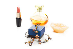Necklace lipstick and perfume Royalty Free Stock Photo