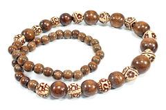 Necklace made of brown wooden balls Royalty Free Stock Images