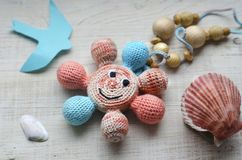 Free Necklace Made From Knitted Beads For The Baby Sitting In A Sling. Royalty Free Stock Images - 129980509