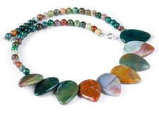 Necklace made of semi-precious gems. On white background Royalty Free Stock Photography