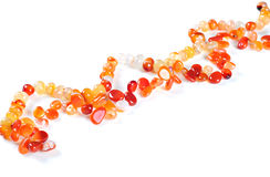Necklace made of semiprecious stones, on white background;. Necklace made of semiprecious stones, over white background; Carnelian stones Royalty Free Stock Photography