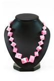 Necklace with many pink stones. Isolated on the white Royalty Free Stock Photography