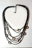 Necklace metal glass plastic ethnic Royalty Free Stock Photos