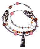 Necklace from natural gemstones and carved figures Stock Photography