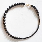 Necklace from natural jet stone beads Royalty Free Stock Image