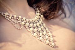Necklace on the neck of bride Stock Photography