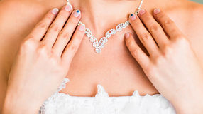 Necklace on the neck of bride Stock Photos