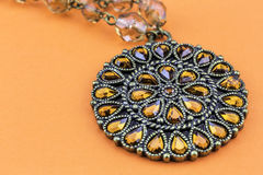 Necklace on Orange Stock Image