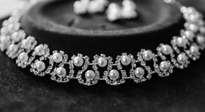 Necklace with pearls. Costly necklace with pearls for a bride on her wedding stock images