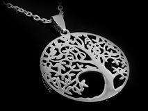 Necklace, Pendant for Women - Symbol Tree of Life - Stainless Steel. One color background Royalty Free Stock Photography