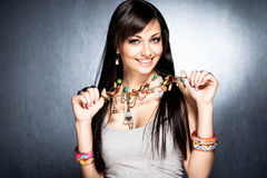 Necklace with pendants. Pretty woman show her colorful necklace with pendants Stock Photography