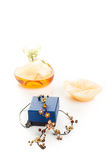 Necklace perfume and candle Stock Images