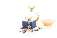 Necklace perfume and candle Stock Photo