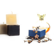 Necklace perfume and candle Royalty Free Stock Photos