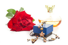 Necklace perfume and rose Stock Photography
