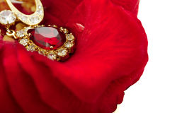 Necklace on the petals of red roses Royalty Free Stock Images