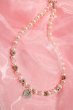 Necklace on pink chiffon Stock Photo