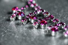 Necklace with pink gem close-up on a light background.  Stock Photo