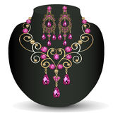 Of necklace with pink jewels and earrings Stock Photo