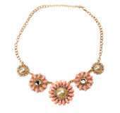 Necklace with pink stones on a gold chain. Royalty Free Stock Photo