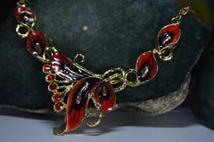 Necklace is a real gold decorated with ruby gems. Beautiful royalty free stock image