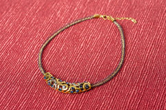 Necklace on Red Background #1 Stock Image