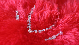 Necklace on red background Royalty Free Stock Images