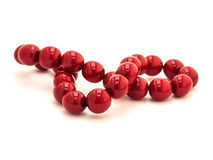 Necklace red. Red necklace of red berries royalty free stock images