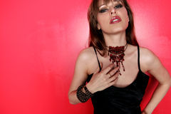 Necklace and red wall Royalty Free Stock Photos