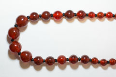 Necklace red on a white background. Ethnic Stock Photos