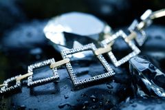 Necklace & rocks Stock Photo