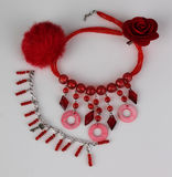 Necklace, rose, puff and bracelet royalty free stock images
