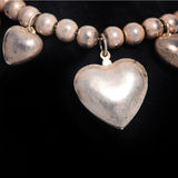 Necklace with a silver heart Stock Photo