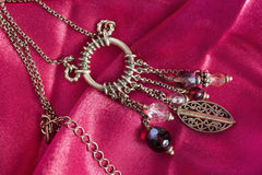 Necklace on satin Stock Photography