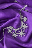 Necklace on satin Royalty Free Stock Images