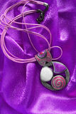 Necklace on satin Stock Images