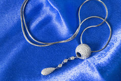 Necklace on satin Stock Photos