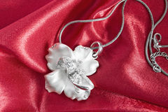 Necklace on satin Royalty Free Stock Photography
