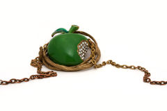 Necklace in the shape of green apple. With golden chain Royalty Free Stock Images
