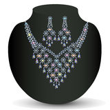Of necklace with shiny jewels and earrings Royalty Free Stock Photo