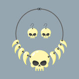 Necklace of skull and tusks. Beads, Aboriginal cannibals and bar Royalty Free Stock Photo