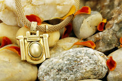 Necklace on stones Royalty Free Stock Photo