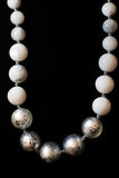 Necklace stones white ball decorations on a black background. Jewelery Royalty Free Stock Image